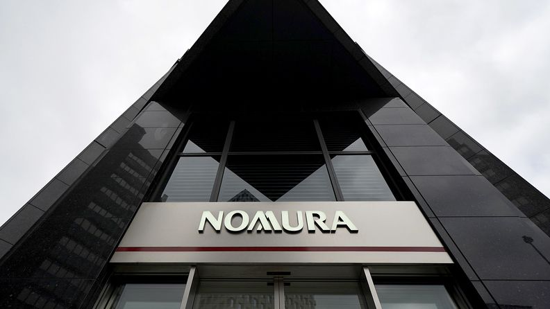 A sign for The Nomura Holdings Inc. is displayed outside a Nomura Securities Co. branch in Tokyo on April 23, 2019