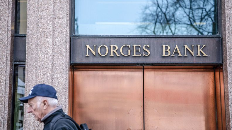 A pedestrian passes the Norges Bank building in Oslo on Feb. 5, 2019