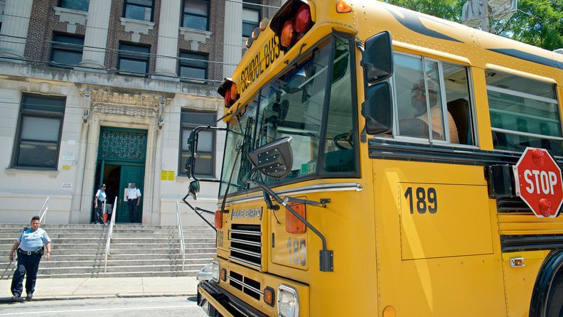 A school bus sits near the main entrance of Germantown High School in the Northwest section of Philadelphia