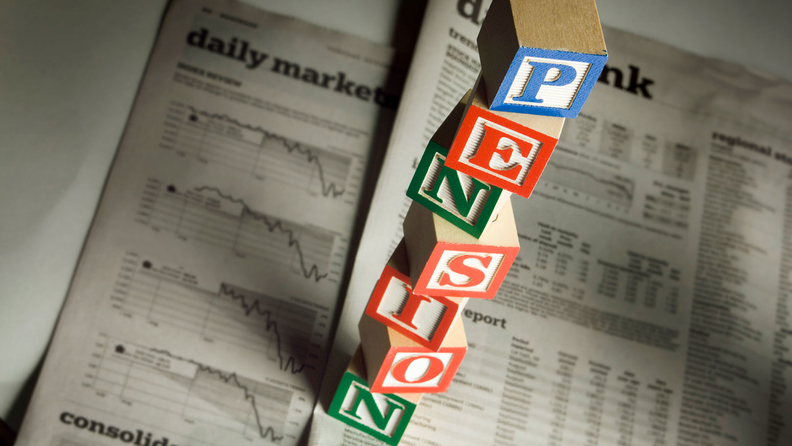 letter blocks spelling out PENSION on newspaper background