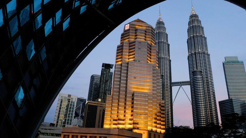 The Petronas Twin Towers are seen from the Saloma Link bridge in Kuala Lumpur, Malaysia, on July 30, 2020