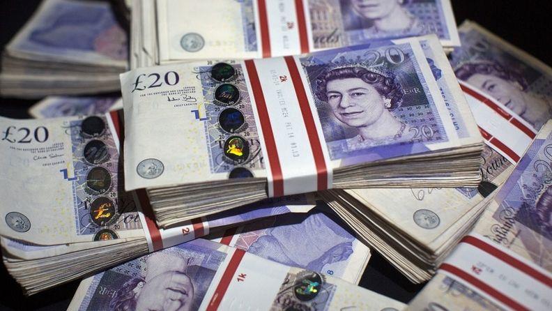 pile of british 20 pound sterling bills