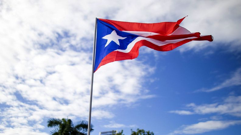 A demonstrators waves a Puerto Rican flag during a protest in San Juan, Puerto Rico, on July 22, 2019.