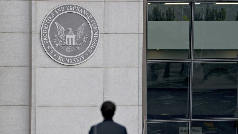 A pedestrian walks near the Securities and Exchange Commission headquarters in Washington