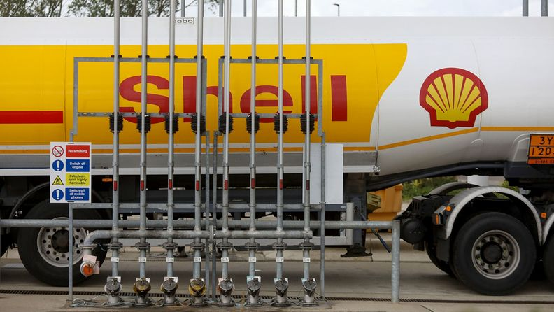 A Shell tanker truck delivers fuel to a gas station, operated by Royal Dutch Shell, in Rotterdam, Netherlands