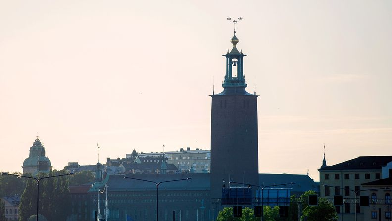 The tower of Stockholm City Hall rise above the city's skyline on Aug. 6, 2020
