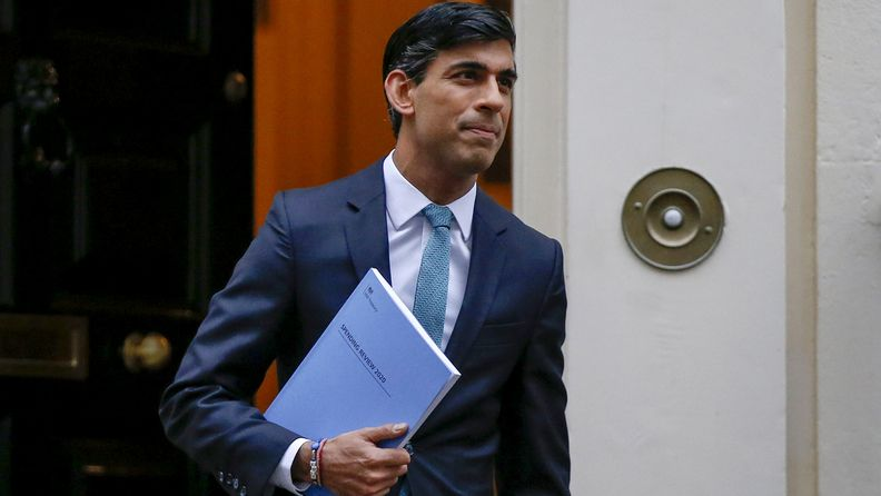 Rishi Sunak, U.K. chancellor of the exchequer, departs Downing Street ahead of the presentation of spending plans at Parliament on Nov. 25, 2020