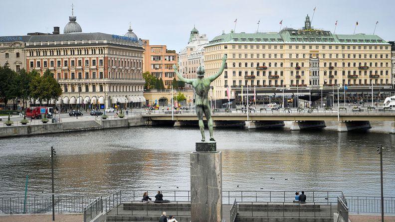 The Solsangaren sculpture stands in view the Svenska Handelsbanken headquarters in Stockholm on Sept. 21, 2020