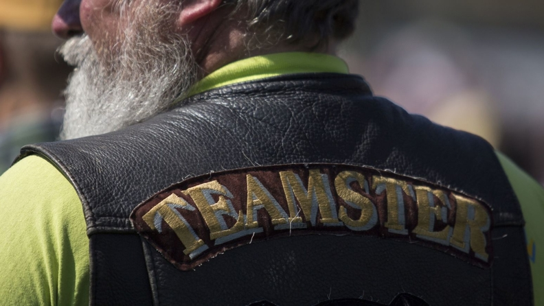 A man wearing a Teamsters jacket attends a rally with members of the International Brotherhood of Teamsters and their supporters outside the Capitol in Washington on April 14, 2016
