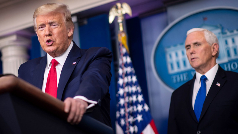 U.S. President Donald Trump speaks while Vice President Mike Pence, right, listens during a Coronavirus Task Force news conference in the briefing room of the White House in Washington, D.C., U.S., on Wednesday, March 18, 2020
