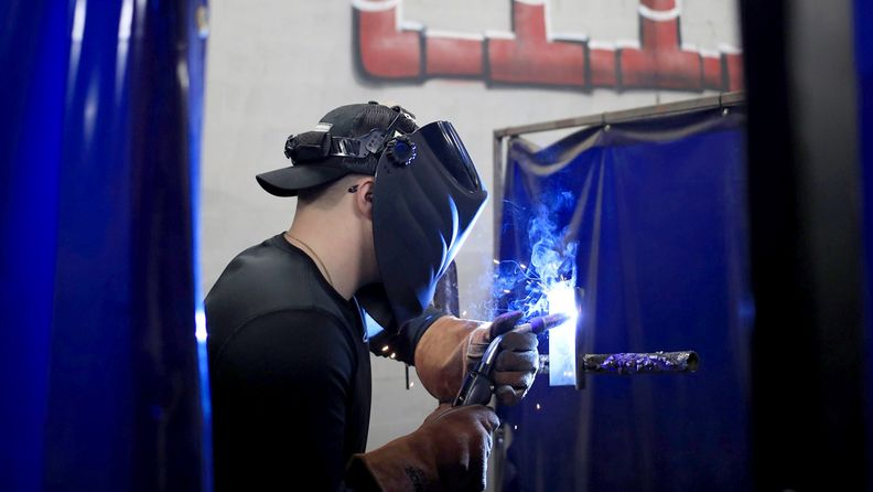 A student practices welding at the Knight School of Welding in Louisville, Ky., on Dec. 3, 2020