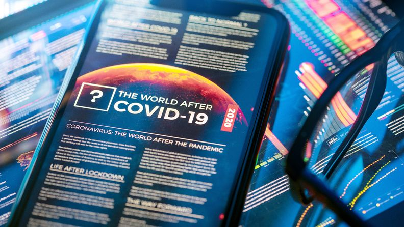 The 'World after COVID-19' article close-up on a smartphone
