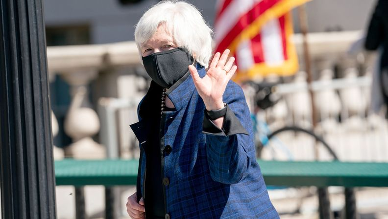Treasury Secretary Janet Yellen waves while exiting after swearing in Wally Adeyemo, deputy Treasury secretary, at the Treasury Department in Washington on March 26, 2021